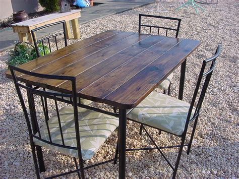 34 x 48 rustic top outdoor table with four matching chairs