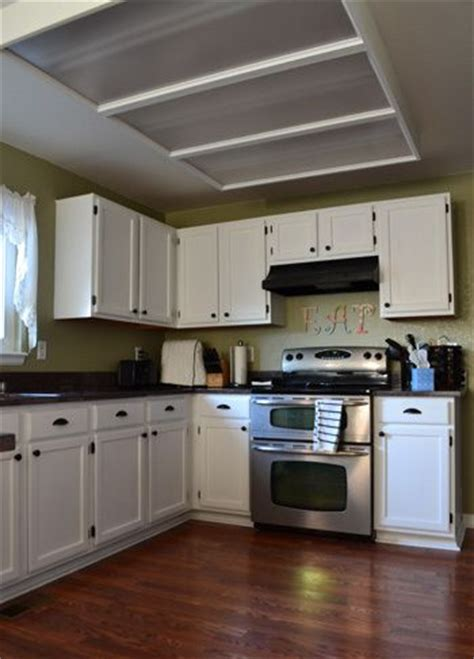 spray painting kitchen cabinets white painting our kitchen cabinets oak kitchen cabinets oak