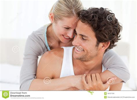 lovely couple in bed lying in bedroom lovely couple hugging on their bed stock photo image of