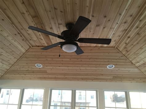 recessed lighting with ceiling fan inside view of screen room hip style roof cedar tongue