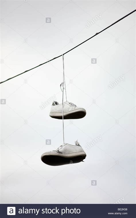 hanging photos on wire a pair of trainers hanging from a telephone wire
