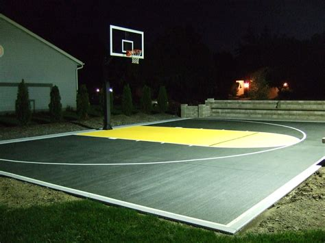 basketball courts with lights during the night a night light is switched on in order to