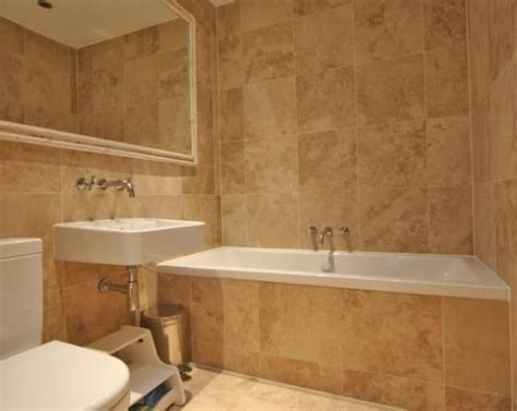 beige bathroom tile ideas photo of modern beige brown orange bathroom with mirror