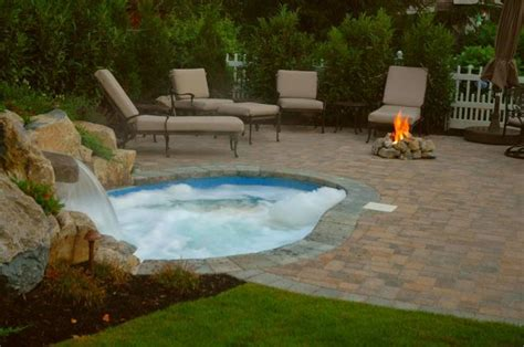 patio pool and spa small backyard this quot spool quot is the solution