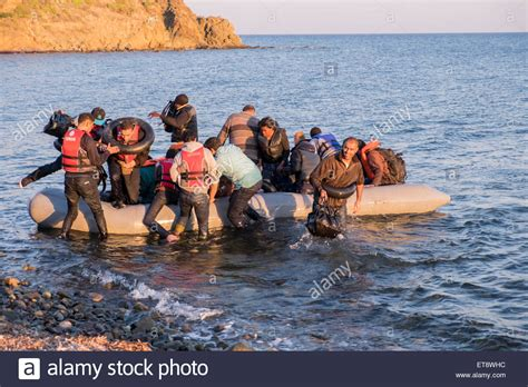refugee boat landing in spain syrian refugees cross from turkey to land on a beach on