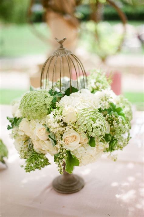169 best bird cages images on pinterest flower arrangements birdcage decor and floral