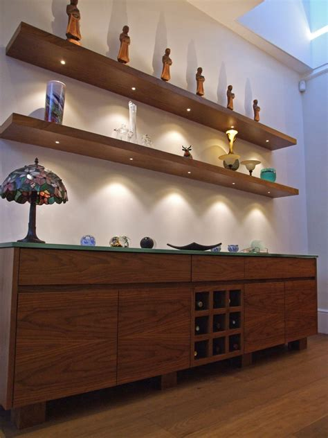 floating shelves with lights and downlight led lighting