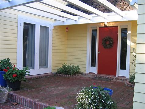 yellow house with red door yellow house with a red front door ideas for our new