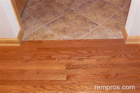 solid wood flooring  transition  porcelain tile