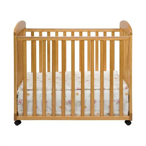 Davinci Alpha Mini Rocking Mobile Wood Baby Honey Oak Crib Davinci Alpha Mini Rocking Crib