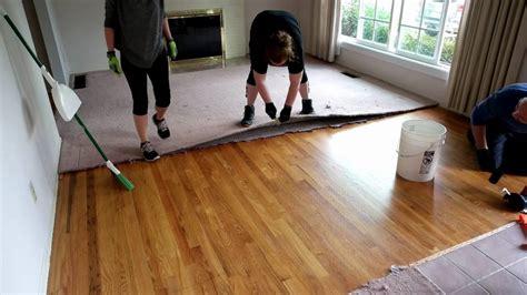 timelapse of carpet removal exposing hardwood floors