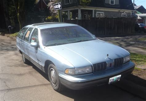 curbside classic capsule 1992 oldsmobile custom cruiser for sale how much will you bid