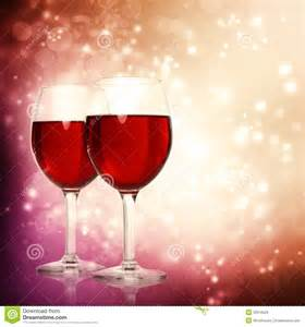 glasses of red wine on a sparkling background royalty free