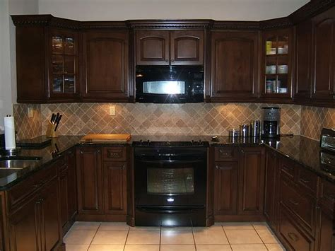 Black Brown Kitchen Cabinets Brown Kitchen Cabinets With Countertop And Lighter Colored Tile Backsplash And Floors