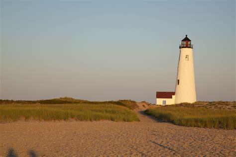picture beach coast dusk lighthouse