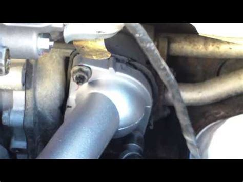 how to replace thermostat and housing 1999 toyota camry