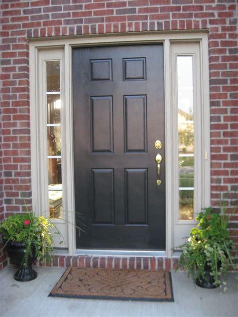 picking   front door   home painted
