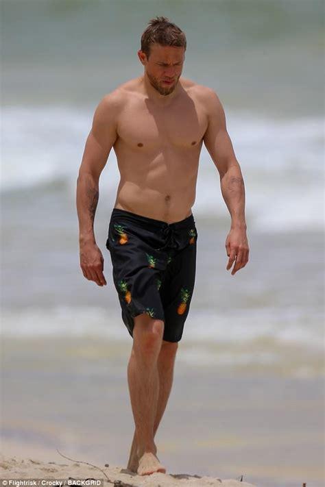 charlie hunnam beach charlie hunnam enjoys beach day with mystery woman daily