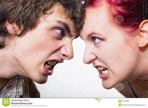 wallpaper of angry couple portrait of an angry couple shouting each other against