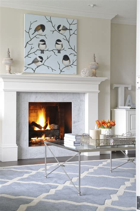 marble mantel fireplace living room designed by enviable designs this fireplace