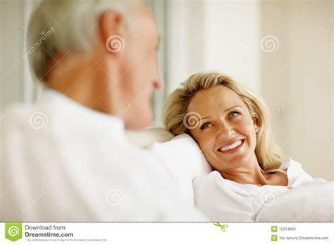 how to make a woman happy in bed how to make a woman happy in bed stock photo happy woman