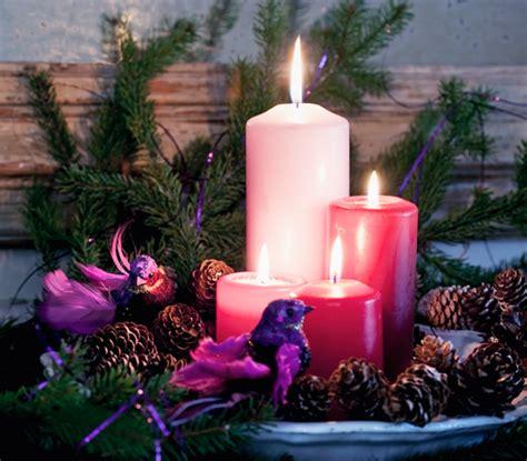 candele economiche centrotavola natalizio con le pigne fai da te idee