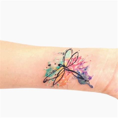 watercolor dragonfly tattoo on wrist