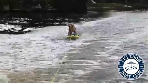 freedom boat club sign in freedom boat club s mascot buddy boy the dog rides on