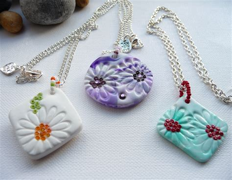 Handmade Polymer Clay - a selection of handmade polymer clay pendants on chains