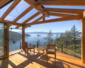 Traditional deck idea in vancouver with a roof extension