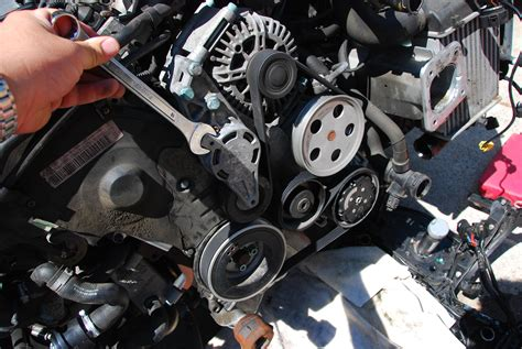 cracked serpentine belt inspection   car