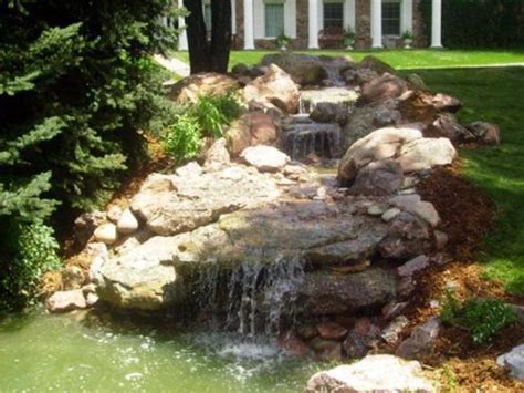 yard features outdoor water spout ideas