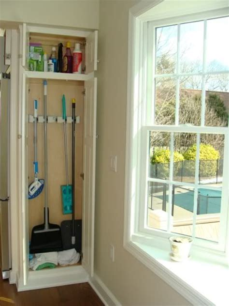 storage cabinets for mops and brooms maybe add a broom closet into an interior wall creative
