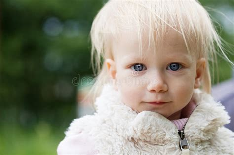 18 month girl haircut cute baby girl with blonde curly hair outdoors stock photo