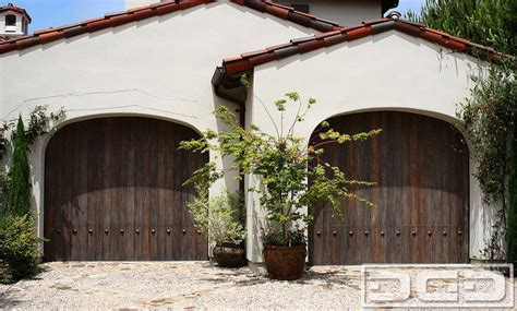 spanish style garage door handcrafted in reclaimed wood