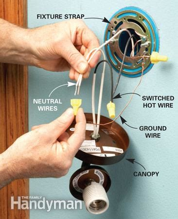 installing a wall mounted light fixture how to add a light the family handyman