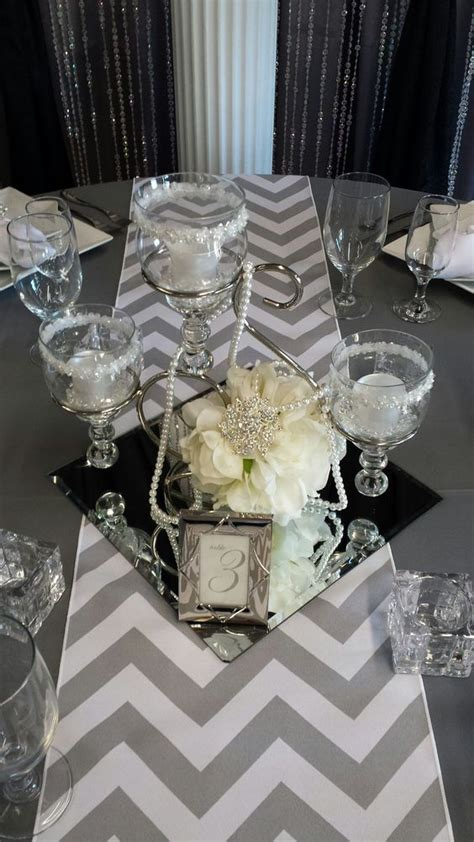 scroll centerpiece with square mirror tile decor