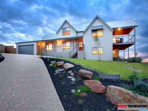 corrugated iron modern house exterior with balcony