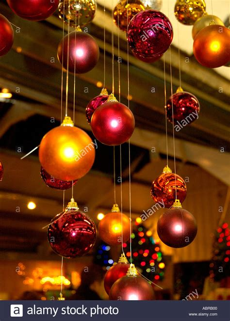 orange coloured christmas decorations coloured glass baubles decorations hanging from stock photo royalty free