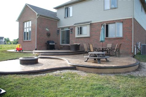 custom designed sted concrete patio w built in pit