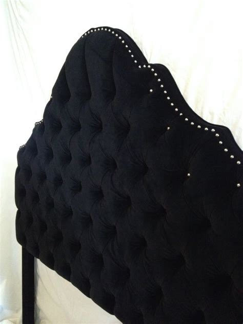 black velvet tufted headboard with nickel nailheads