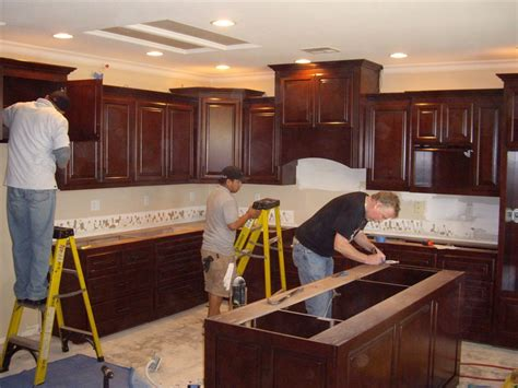Installing Cabinets kitchen cabinets in southern california c and l designs