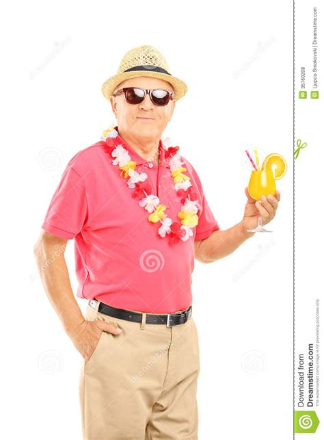 man holding martini happy middle aged man on a vacation holding a cocktail