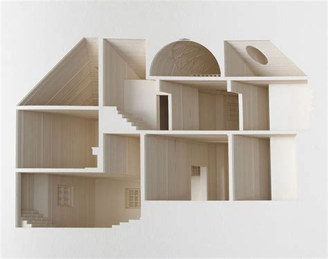 your house the negative space of a house cut inside a 908 page book