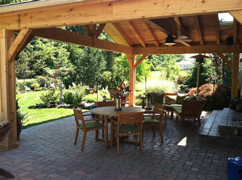 backyard porches and decks let the sun shine through with an open porch design in