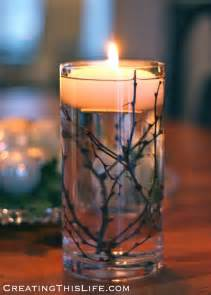Rustic Tablescapes winter centerpiece with twigs and floating candles