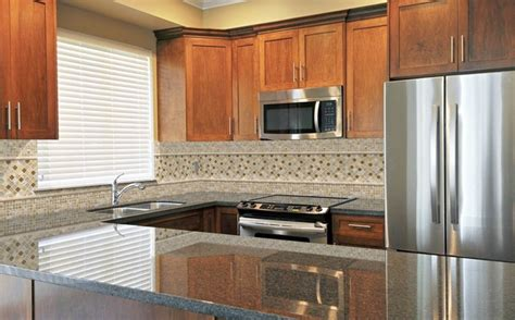 Kitchen Cabinets With Granite Countertops ubatuba granite countertop traditional kitchen