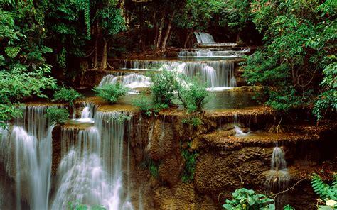 green cascade waterfall green forest rocks computer