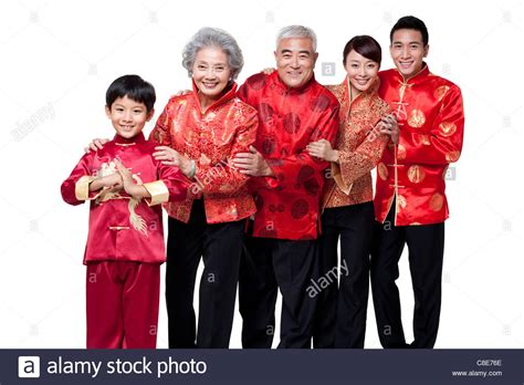 family dressed in traditional clothing celebrating chinese