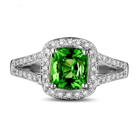 beautiful 2 carat cushion cut emerald and halo